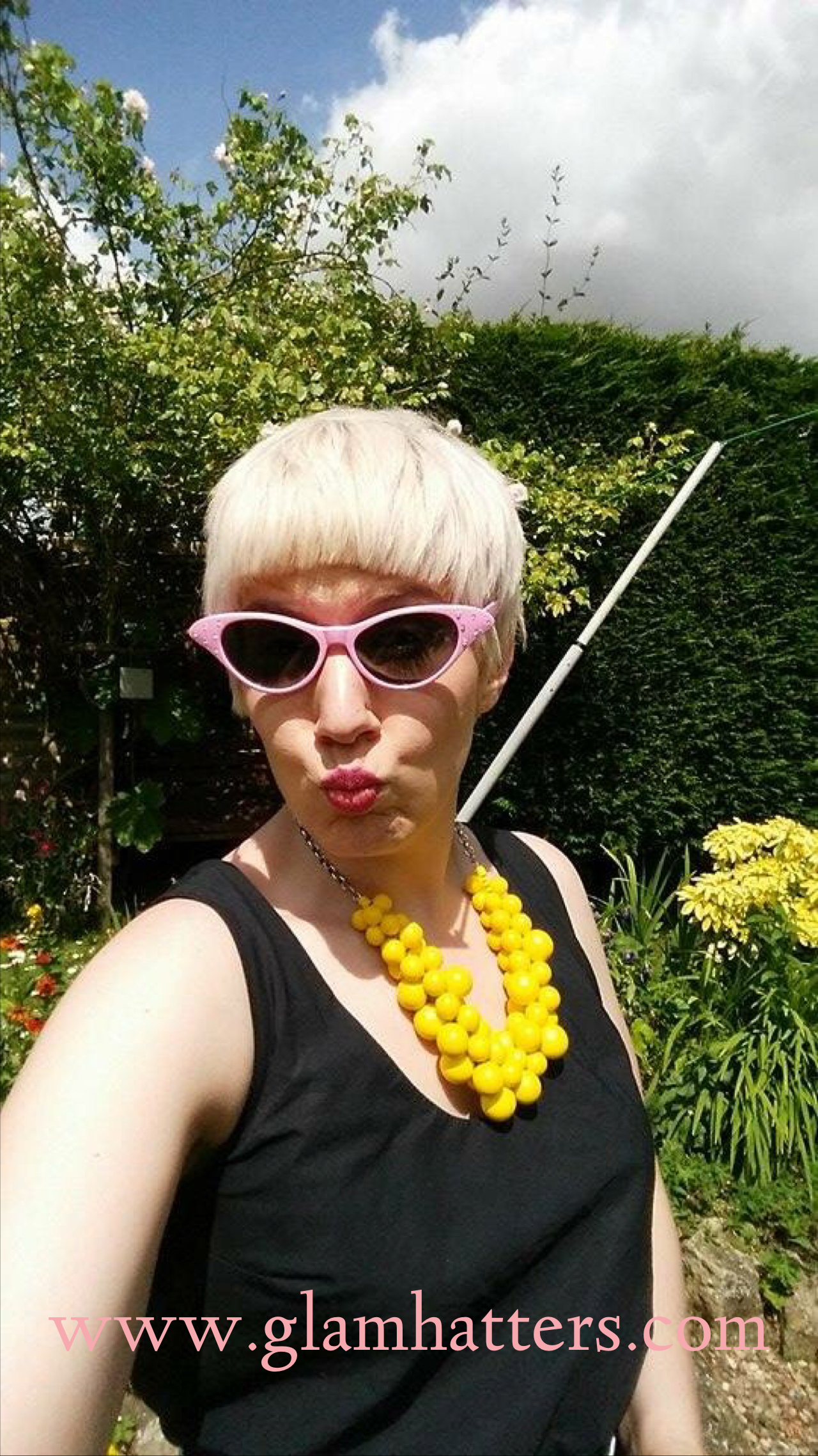 Our Glam Hatter Girl wearing her goody bag sunnies!